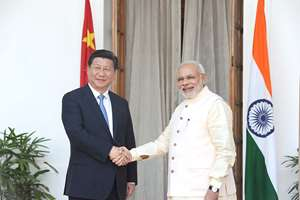 Prime Minister, Narendra Modi shaking hands with the Chinese President, Xi Jinping in New Delhi.