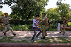 Policemen detain a Tibetan youth activist during a protest to highlight Chinese control over Tibet, outside the Hyderabad House where Chinese President Xi Jinping and Prime Minister Narendra Modi are holding talks in New Delhi.