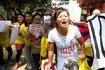 Tibetans protest against Chinese President Xi Jinping outside Hyderabad House, in New Delhi.