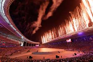 Fireworks explode from the roof of the Asiad Stadium during the opening ceremony for the 17th Asian Games in Incheon, South Korea.