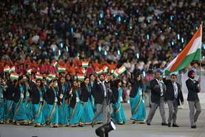Athletes from India lead by men's hockey team captain Sardar Singh, right, march into Incheon Asiad Main Stadium during the opening ceremony for the 17th Asian Games  in Incheon, South Korea.