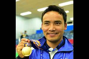 Gold medal winner India's Jitu Rai poses at the medal ceremony of Men's 50M Pistol shooting event at the 17th Asian Games in Incheon, South Korea.