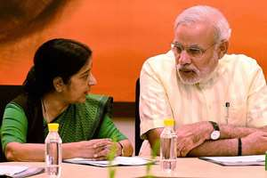 Prime Minister Narendra Modi with Union External Affairs Minister Sushma Swaraj during the party's parliamentary board meeting in New Delhi.