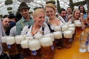 Waitresses Beli, right, and Anika pose with beer mugs during the opening of the 181th Oktoberfest beer festival in Munich, southern Germany. The world's largest beer festival will be held from Sept. 20 to Oct. 5, 2014.