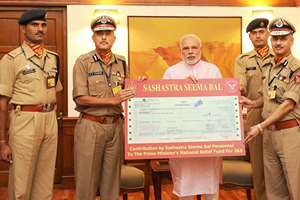 The Director General, Sashastra Seema Bal, B.D. Sharma, calls on the Prime Minister, Narendra Modi, and handed over a demand draft of Rs 2.12 crore towards the Prime Minister's National Relief Fund, for flood-affected people of Jammu and Kashmir, in New Delhi.