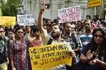 Students take part in a rally against the alleged molestation of Jadavpur University female student in New Delhi.