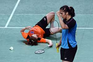 India's Saina Nehwal celebrates after scoring a point against Thailand's R Invtanon during their Badminton singles quaterfinal match at Asian Games 2014 in Inchoen, South Korea.