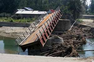 A bridge that connects Pulwama to Srinagar lays destroyed due to the Jammu and Kashmir flood devastation in Pulwama.