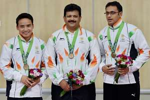 India's Bronze medalist, from left to right,Jitu Rai, Samaresh Jung and Prakash Papanna Nanjappa  pose for photographers during the victory ceremony for the Men's 10m Air Pistol Team shooting competition at the 17th Asian Games at Ongnyeon International Shooting Range in Incheon, South Korea