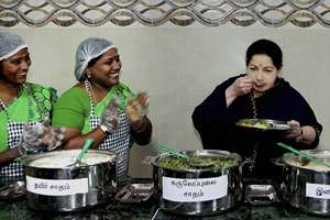 Tamil Nadu CM J Jayalalitha tasting food after launching an Amma Unavagam (Amma Canteen) at a government hospital in Chennai.