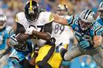 Pittsburgh Steelers' LeGarrette Blount (27) runs between Carolina Panthers' Robert Golden and Luke Kuechly for a touchdown during the second half of an NFL football game in Charlotte, North Carolina. The Steelers won 37-19.