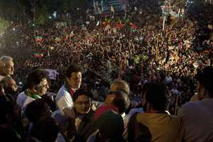 Pakistan's cricketer-turned-politician Imran Khan, fourth from left, delivers a speech during a rally in Karachi, Pakistan. Anti-government demonstrators led by opposition politician Khan rallied in Pakistani port city Karachi, demanding Prime Minister Nawaz Sharif's ouster over alleged fraud in last year's election.