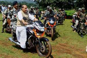 Union Home Minister Rajnath Singh rides a motorcycle at Thalkobad CRPF camp in Saranda forest of Chaibasa in Jharkhand.