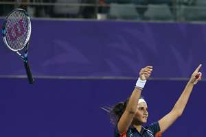 Sania Mirza celebrates after winning the gold medal of the mixed doubles tennis match at the 17th Asian Games in Incheon, South Korea.