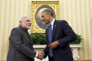 Prime Minister Narendra Modi and President Barack Obama shake hands after briefing the media in the Oval Office of the White House in Washington.