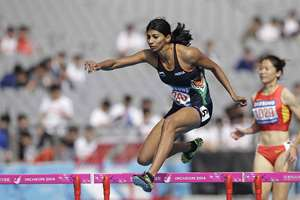 India's Ashwini Chidananda Akkunji clears hurdle in the women's 400m hurdles heat at the 17th Asian Games in Incheon, South Korea.