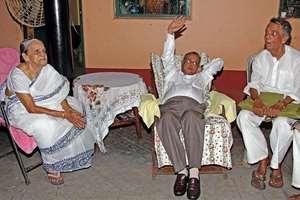President Pranab Mukherjee with his elder sister Annanapurna Bandapadhay (L) & elder brother Pijush Mukhopadhaya (R) at his ancestral village Mirati to attend the family's Durga Puja in Birbhum district of West-Bengal.