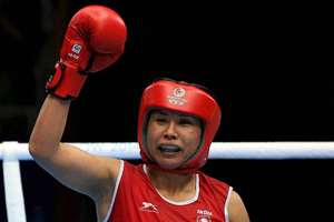 File Photo: Controversy hit the Asian Games boxing competition after India's L Sarita Devi (60kg) had to settle for a bronze medal despite dominating her semifinal bout even as M C Mary Kom (51kg) continued her winning run to enter the summit clash of the mega-event.