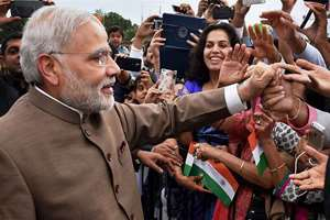 Prime Minister Narendra Modi greets Indian Americans on his arrival at Andrews Air Force Base in Washington DC.