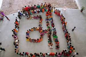 School children make a formation which represents the word Maa (Mother) during Navratri festival in Surat.