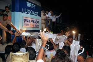 An injured is taken to the hospital after Krishak Express and Barauni Express collided near Gorakhpur on Tuesday night.