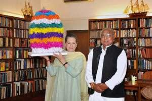 Congress leader & MP V Hanumantha Rao presents a Bathukamma to Congress President Sonia Gandhi at 10 Janpath in New Delhi. Bathukamma is a festival celebrated by Hindu Women of Telangana.