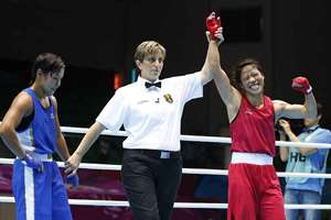 MC Mary Kom celebrates as she is announced winner of the women's flyweight (48-51kg) final boxing match against Kazakhstan's Zhaina Shekerbekova at the 17th Asian Games in Incheon, South Korea. Kom became the first Indian woman boxer to clinch a gold medal at the Asian Games.