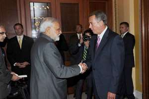 Prime Minister Narendra Modi greets the US House of Representatives speaker John Boehner in Washington DC.