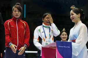 L. Sarita Devi cries standing beside bronze medalist Vietnam's Thi Duyen Luu after she refused her bronze medal during the medal ceremony for the women's light 60-kilogram division boxing at the 17th Asian Games in Incheon, South Korea. India's protest against the outcome of an Asian Games boxing semifinal that was awarded to South Korea's Park Ji-na over Devi in the women's 60-kilogram division was rejected. Devi rejected her medal in protest against the result.