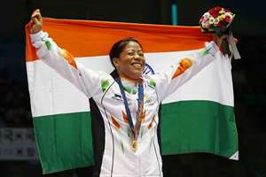 M.C. Mary Kom holds the national flag and celebrates her gold medal in the women's flyweight (48-51kg) final boxing match at the 17th Asian Games in Incheon, South Korea.