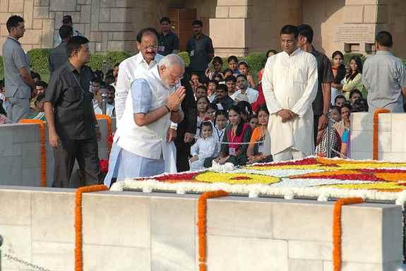 Prime Minister, Narendra Modi paying homage at the Samadhi of Mahatma Gandhi on his 145th birth anniversary, at Rajghat, in Delhi.
