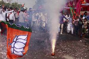 BJP workers burst crackers while celebrating the party victory in the Assembly polls in Gurgaon.