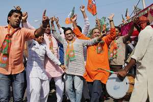 BJP workers celebrate the party's victory in the Assembly polls in Gurgaon.