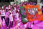 BJP supporters celebrate the party's victory in Assembly polls in Nagpur, Maharsahtra.