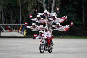 Members of Shwet Ashw, the motorcycle display team of the Indian army, performs during the platinum jubilee celebrations of Corps of Military Police in Bengaluru.