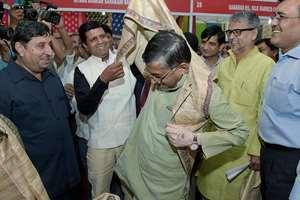 "Minister of State Textiles Santosh Kumar Gangwar tries a jacket presented at the ""Silk Fab"" – Exhibition-cum-sale of exquisite silk handloom fabrics, in New Delhi."