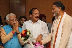Union Minister Venkaiah Naidu and Haryana BJP President Ram Bilas Sharma greeting Chief Minister-designate Manohar Lal Khattar in Chandigarh.