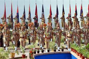 Police personnel pay homage to martyrs during the Police Commemoration Day at the Police Memorial in New Delhi.