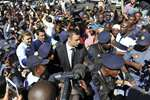 Oscar Pistorius, center, arrives outside the court in Pretoria, South Africa. Pistorius will finally learn his fate when judge Thokozile Masipais is expected to announce the Olympic runner's sentence for killing girlfriend Reeva Steenkamp.