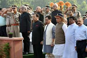 Union Home Minister Rajnath Singh with MoS for Home, Kiren Rijiju, Union Minister for Tribal Affairs, Jual Oram, MoS  PMO, Jitendra Singh, CBI director Ranjit Sinha, Delhi Police Commissioner BS Bassi along with Director Generals of other forces salute to martyrs at the Police Memorial on the occasion of Police Commemoration Day in New Delhi.