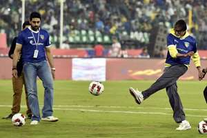 Amitabh Bachchan and Chennaiyin FC co owner Abhishek Bachchan during the Indian Super League match between Chennaiyin FC and Kerala Blasters FC in Chennai.