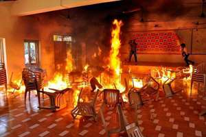 TRS activists set chairs on fire at the TDP office in Nalgonda during a protest over the issue of power generation in Srisailam Project.