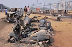 Charred vehicles at the crackers market in Faridabad a day after the major fire.