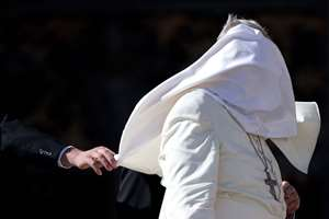 A gust of wind blows Pope Francis mantle as he leaves St. Peter's Square at the Vatican after his weekly general audience.