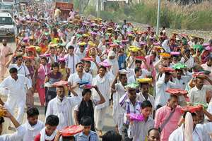 Gaudiya Math devotees carrying sweets, curd, milk & other material to worshp Goverdhan hillock on the occasion of Goverdhan Puja in Mathura.