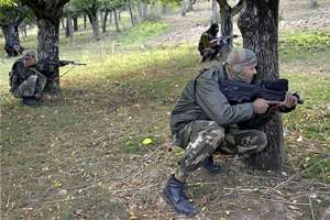 Army personnel take positions during an encounter with militants at Rajwara in Handwara district, Jammu & Kashmir.