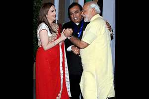 Prime Minister Narendra Modi is welcomed by Reliance Foundation Chairperson Nita Ambani and Mukesh Ambani on his arrival for the re-dedication and inauguration of HN Reliance Foundation Hospital in Mumbai.