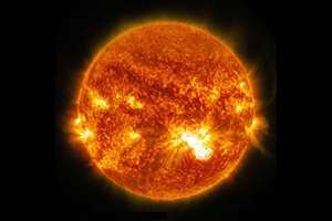 This image provided by NASA shows the sun emitting a significant X3.2-class flare erupting from the lower half of the sun, peaking at 5:40 p.m. EDT. NASA's Solar Dynamics Observatory, which watches the sun constantly and captured images of the event.