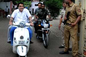 Union Transport and Highways Minister Nitin Gadkari rode into a controversy when he was caught on camera entering RSS headquarters here on his scooter without wearing a helmet in violation of traffic rules.