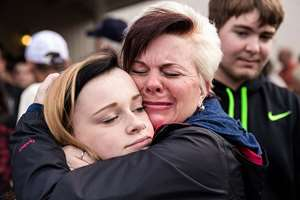 Sobbing after being reunited, mother Colleen Epstein, right, embraces her daughter, Meaghan Epstein, left, a junior at Marysville Pilchuck High School, near the scene of a school shooting that left two dead and four wounded, at Marysville Pilchuck High School in Marysville, Washington.